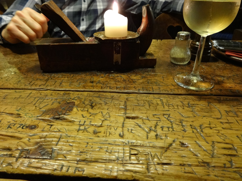 Ancient wooden table at Schnitzelbank